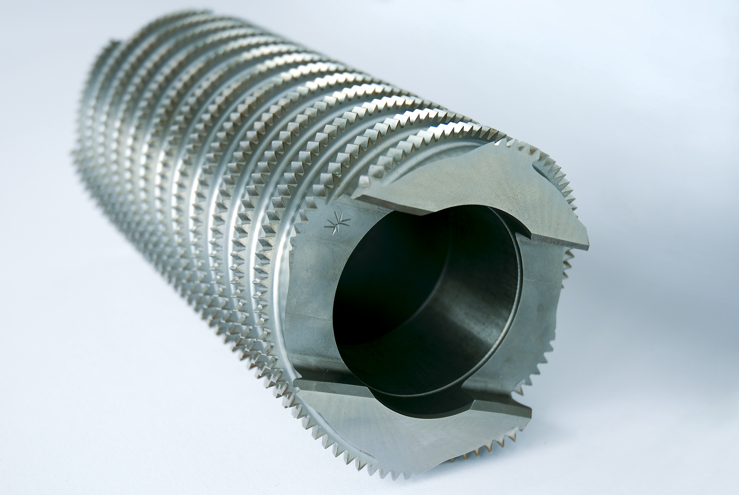 Helical broaching tools with full form finishing shells